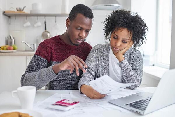 A couple completing a budget