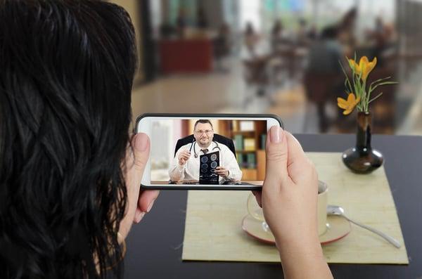 Women using telehealth on mobile