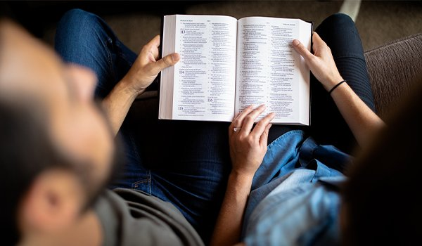 dad reading bible with son