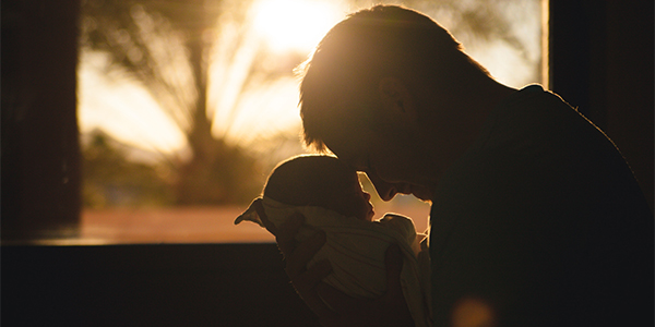 father and baby in morning light