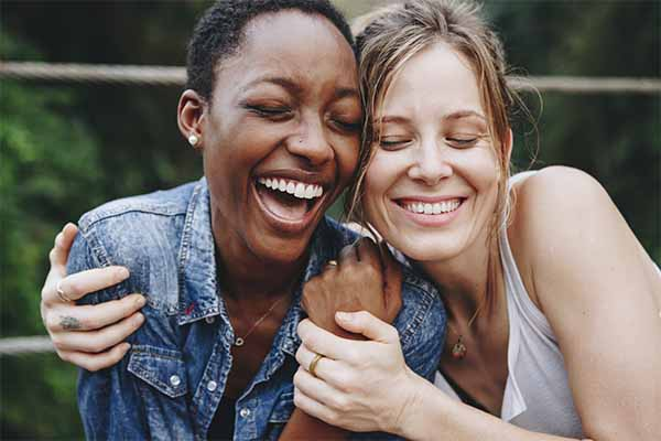 friends hugging and smiling