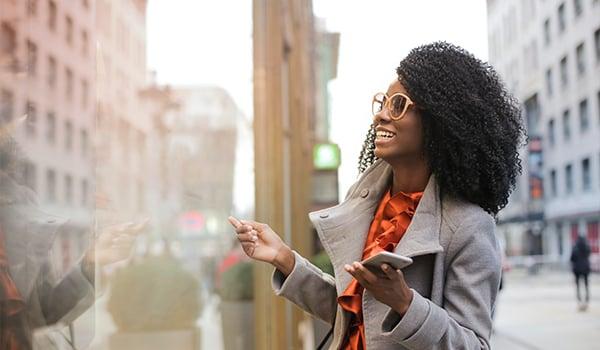 happy black woman in city