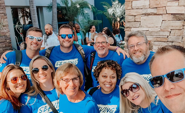 Group of Christian Care Ministry employees smiling in matching shirts