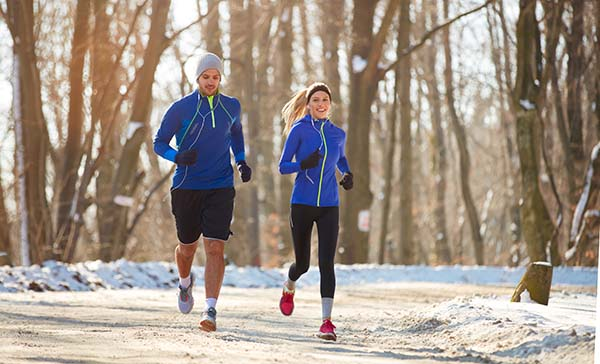 Couple running in cold weather