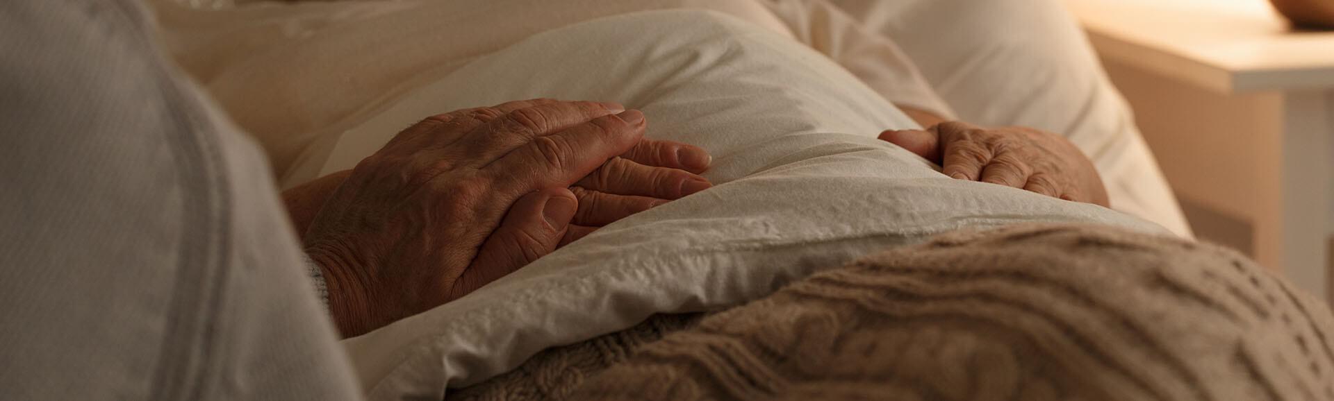 Senior man comforting his wife