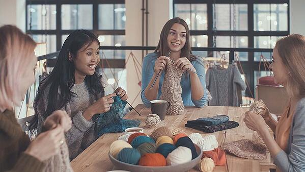 Friends knitting together