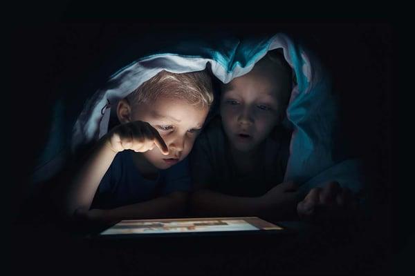 Kids watching tablet at night