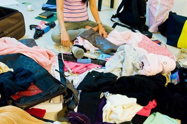 Woman sitting in clutter