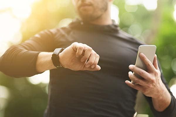 Man wearing fitness watch