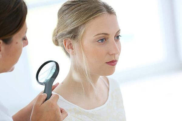 Dermatologist checking for skin cancer