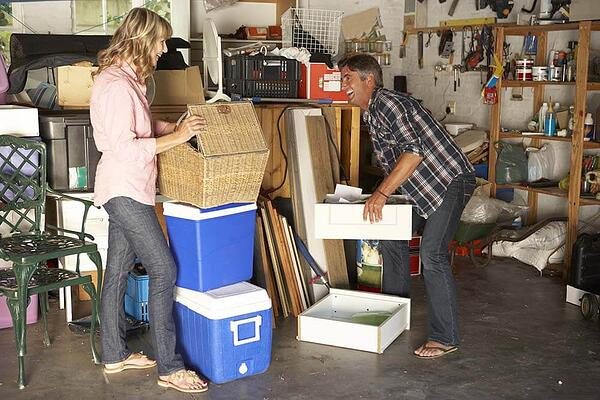 Couple cleaning out garage