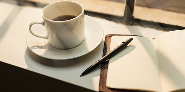 coffee cup and journal