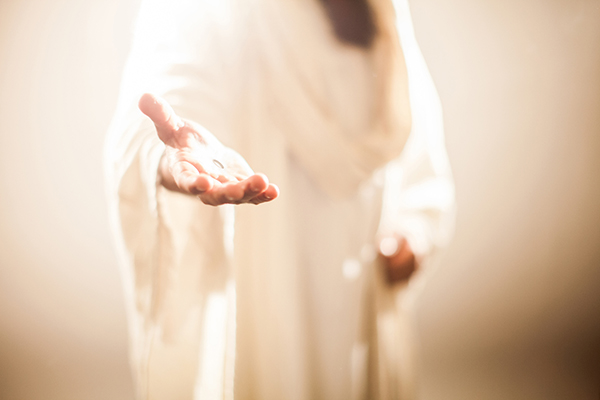 Jesus holding his hand out