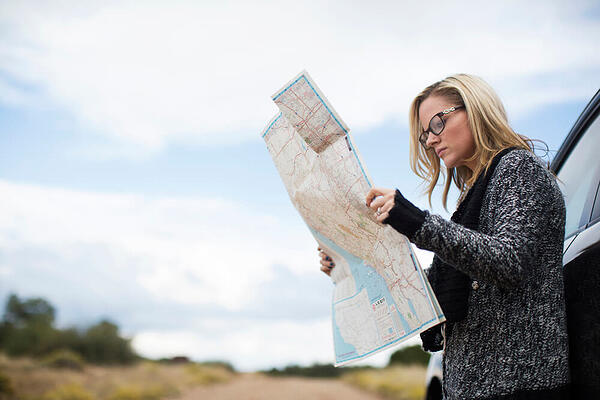 Woman trying to find her way on a map