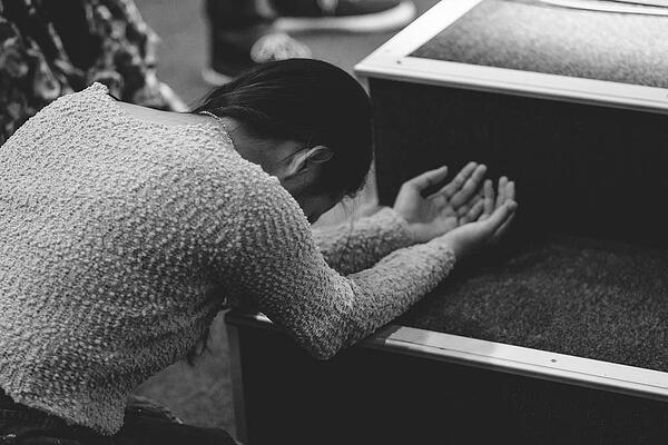 Woman bowing in worship