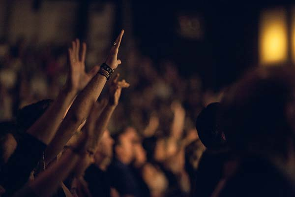 Crowd raising their hands in worship