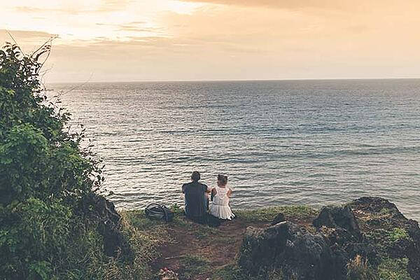 Man and woman on a cliff