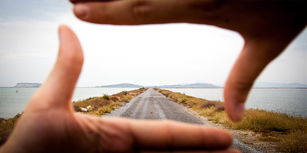 road framed in hands