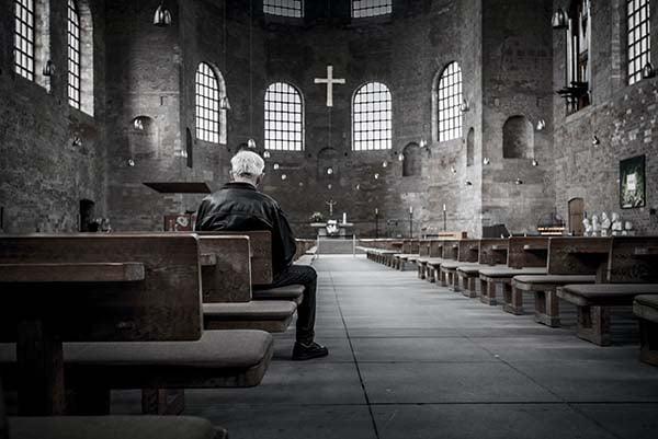 Man in a church praying