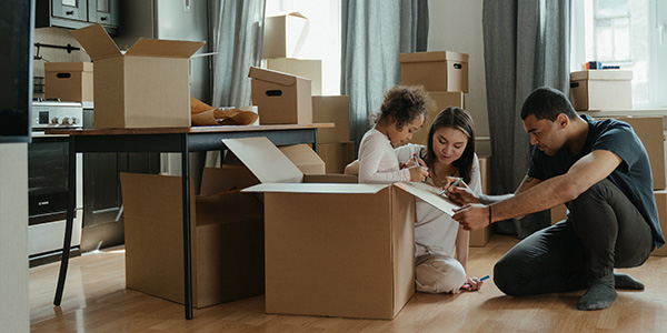 family packing boxes in living room