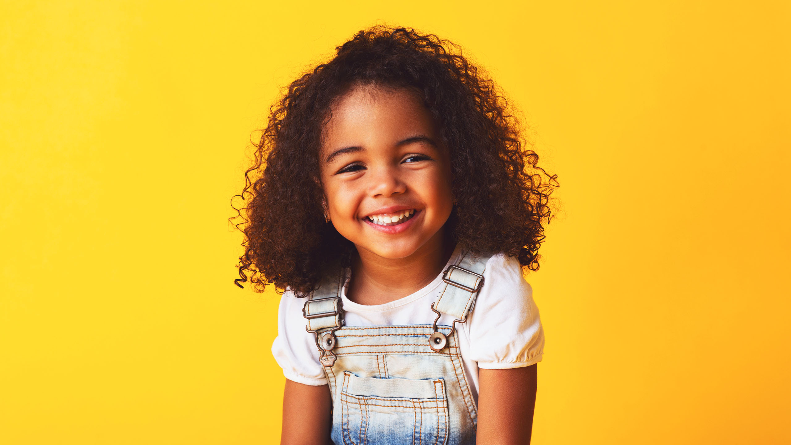 A young child smiling for a photograph