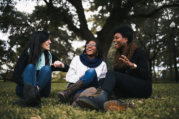 Friends laughing in the park