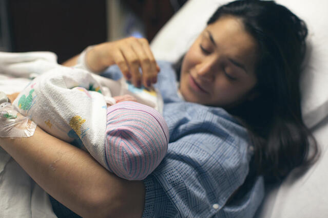 Mother holding her newborn baby