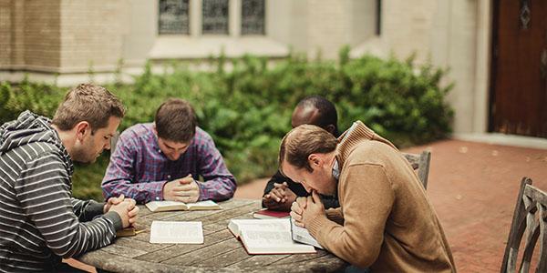 mens group praying